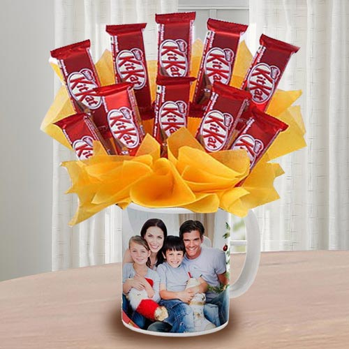 Exclusive Kitkat Chocolates Arrangement in Personalized Coffee Mug