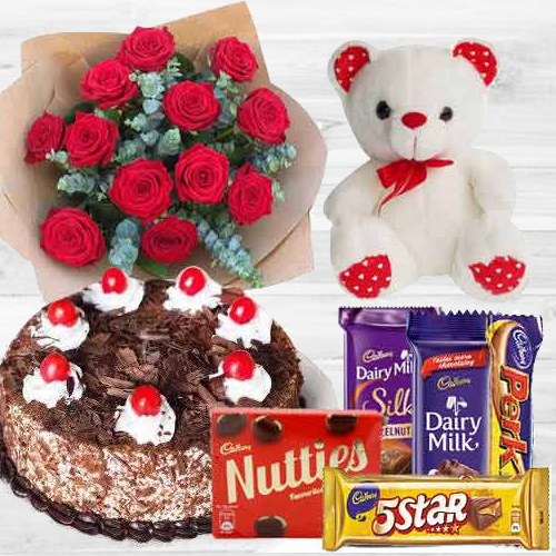 Awesome Bouquet of Dutch Red Roses with Cake, Mixed Cadburys Chocolates and a Teddy Bear<br>