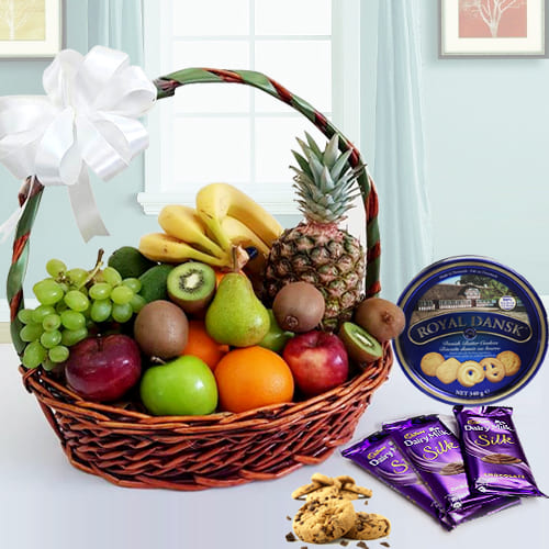 Enticing Fresh Fruits Basket with Danish Cookies N Chocolates