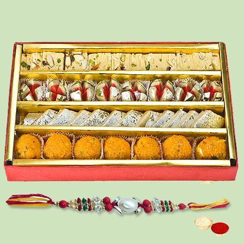 Impressive Arrangement of Rakhi and Assorted Sweets with Roli Tilak N Chawal for Caring Brother