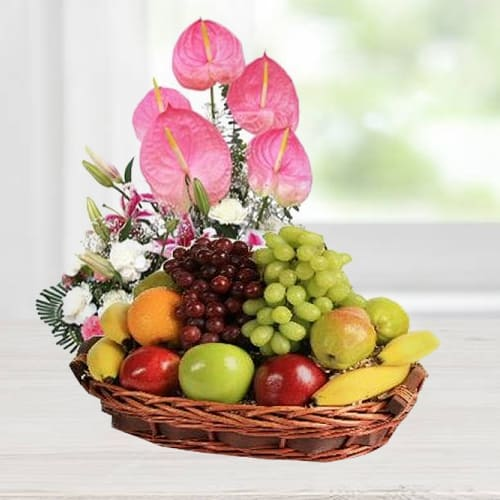 Classically-Styled Fruits Basket decorated with Anthodium, Lily n Carnations