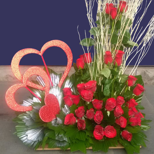 Charismatic Arrangement of Red Roses with Triple Heart
