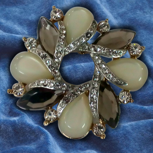 Poignant Opal Rhinestone Brooch Cum Pendant from the Collection of Avon