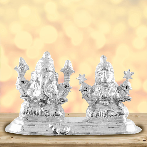 Divine looking silver plated Laxmi Ganesh idol