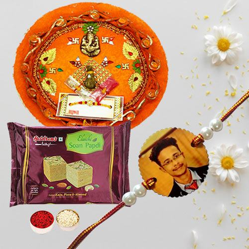 Photo Rakhi with Haldirams Papdi N Pooja Thali